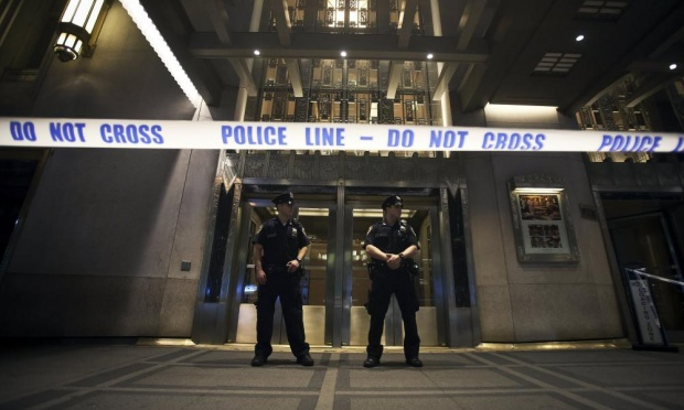 Police stand guard at the main entrance to the Waldorf Astoria hotel.
